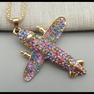 Betsey Johnson airplane necklace.